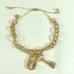 Lock & Key gold tone adjustable chain bracelet